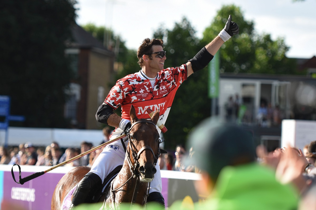 Polo player saluting the crowd